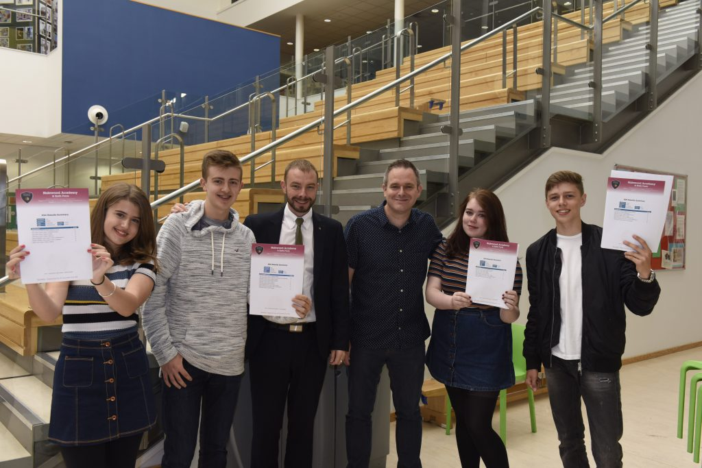 High performing Halewood Academy pupils Amy Sinker, Alex Watson, Elle Hughes and Charlie White with Cllr Gary See and Principal of Halewood Academy Gary Evans.