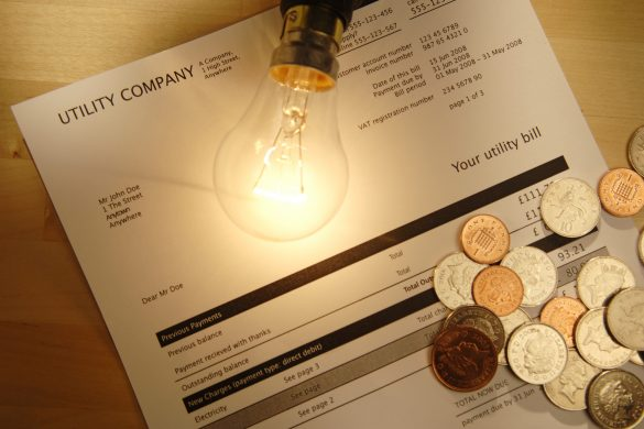 utility bill with lightbulb and coins