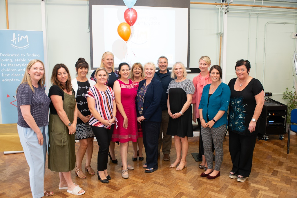 Staff from the new Regional Adoption Agency, Aim, celebrate its launch event.