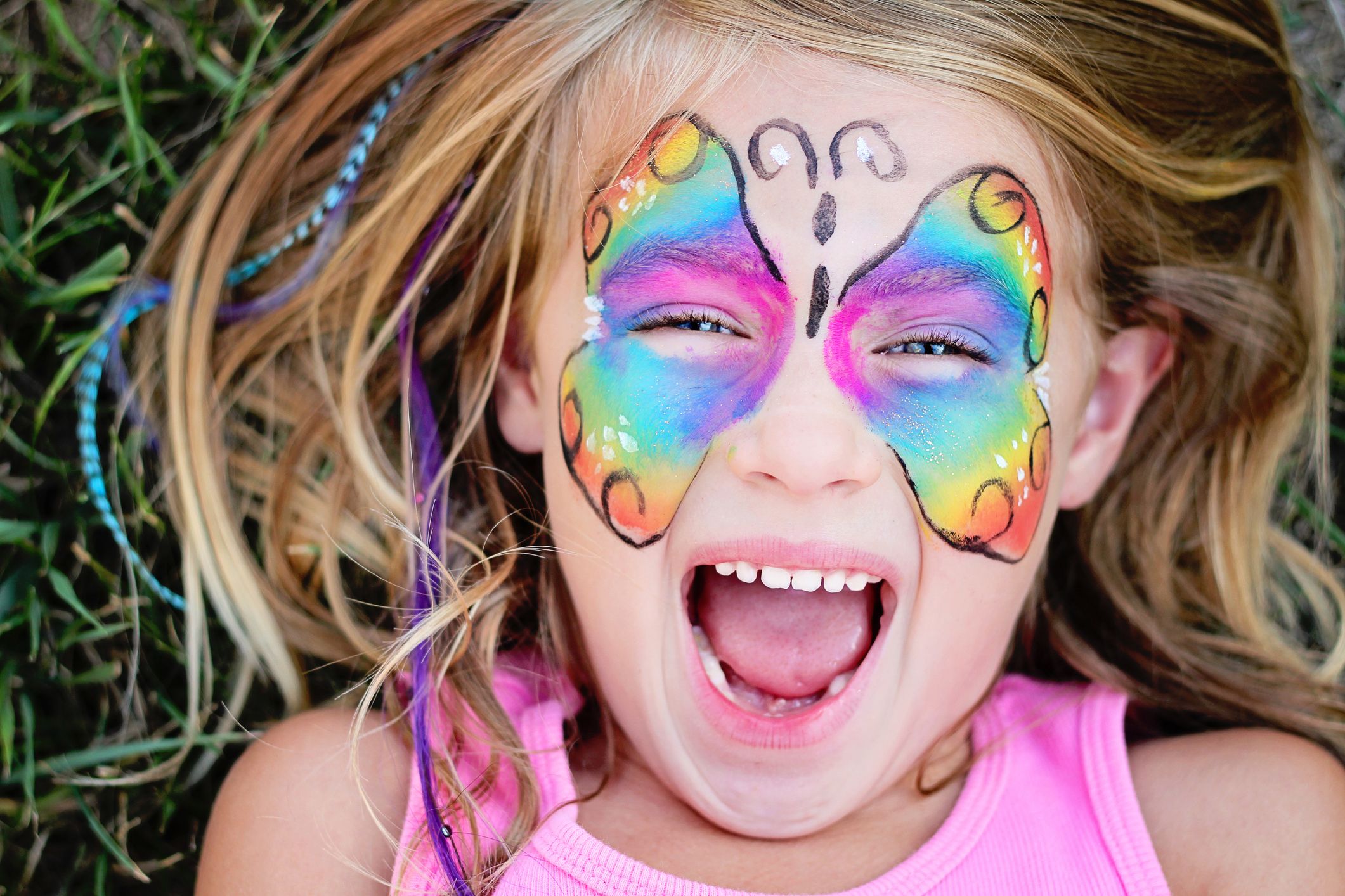 Little girl with a butterfly painted face