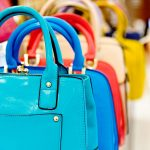 Colourful handbags on sale in a shop