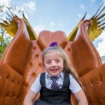 School girl sat on one of the three Kirkby thrones