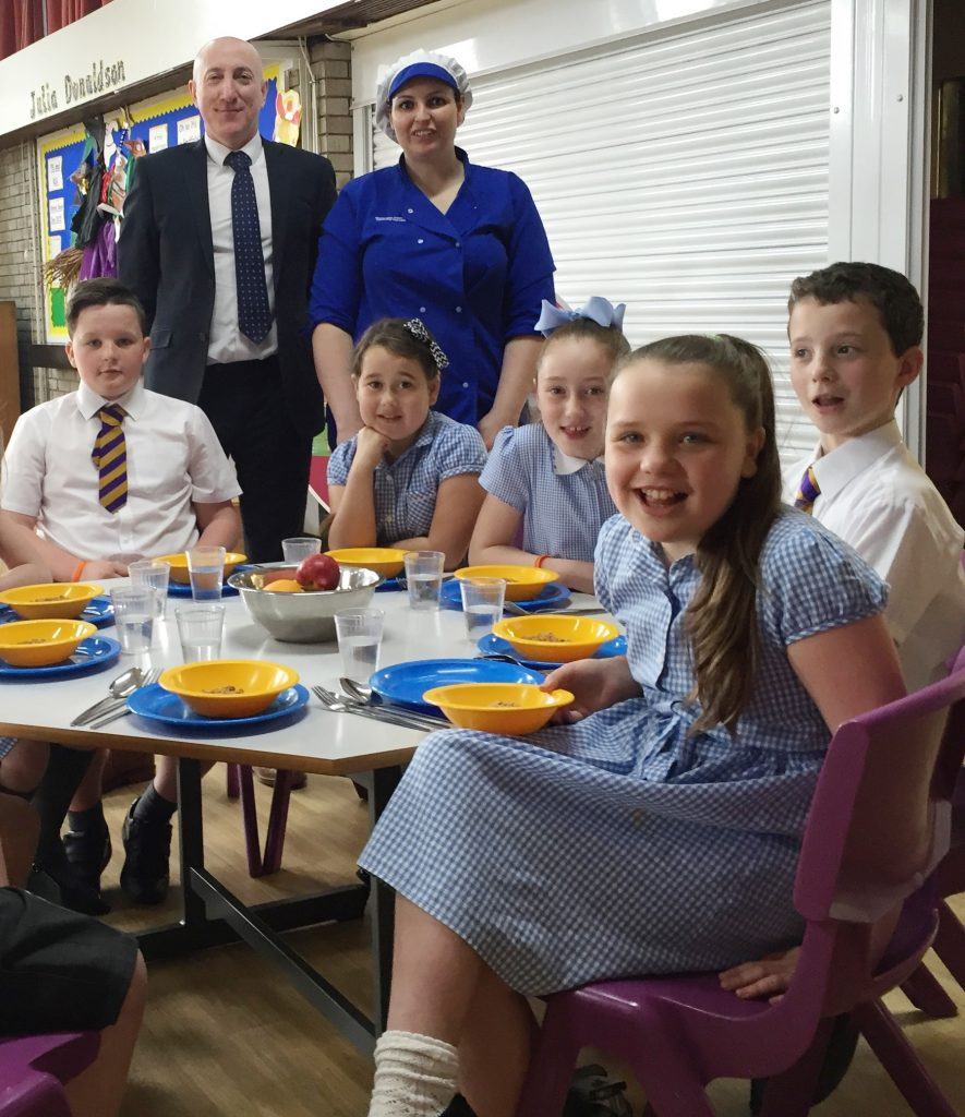 Head teacher Charlie Newstead and chef Charlotte Hoey with pupils at St Joseph's Primary School