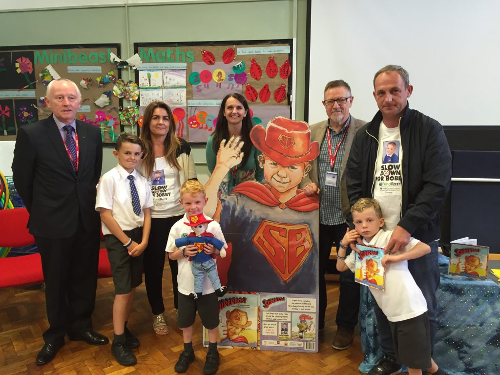 Cllr Murphy with Bobby's family, author Jude Lennon and illustrator Alan Jones