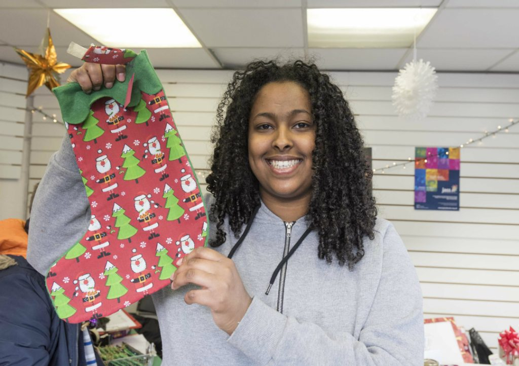 Bluebell Park student Ekran with Christmas stocking at school's pop-up shop in Kirkby