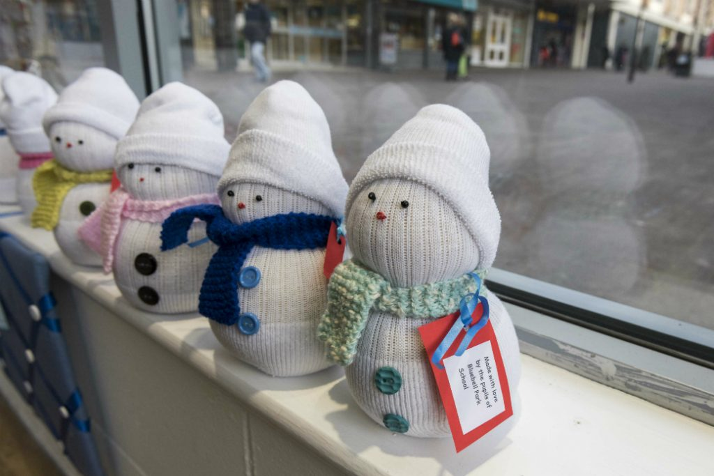 Knitted snowmen on sale in Bluebell Park School's pop-up Christmas shop in Kirkby