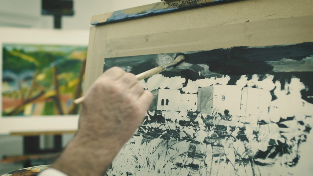 Willy Russell painting a piece