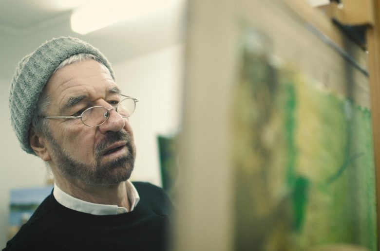 Willy Russell painting at an easel