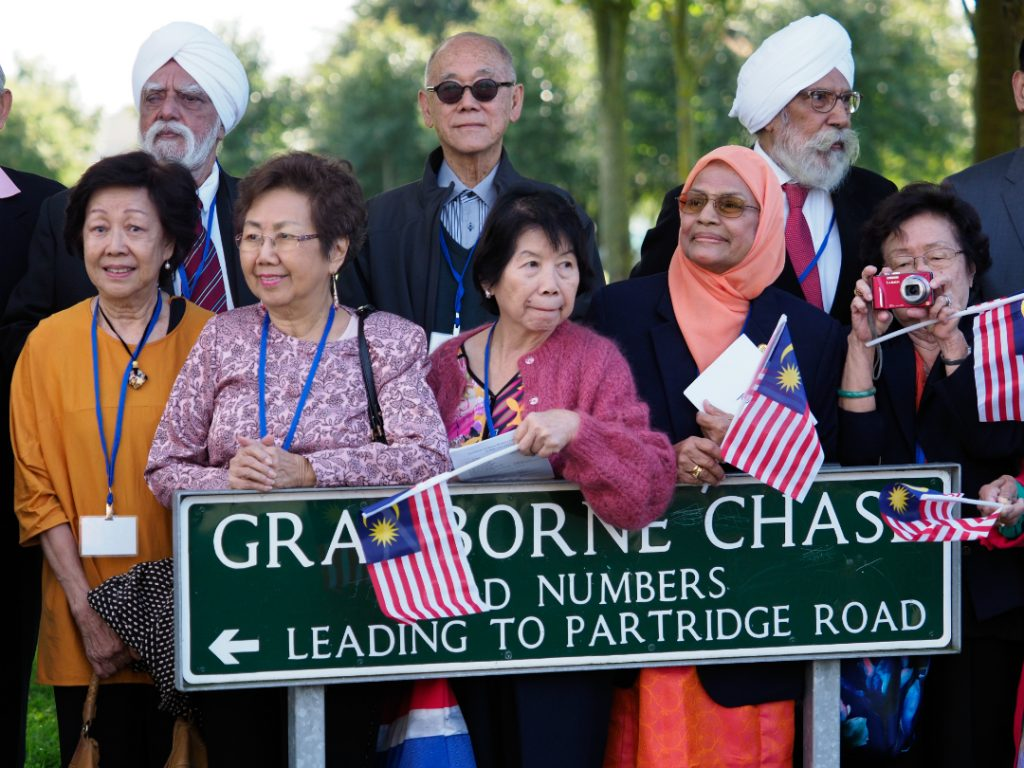 Some of the former students of the Malayan Teacher Training College in Kirkby back at Granborne Chase, where it once stood