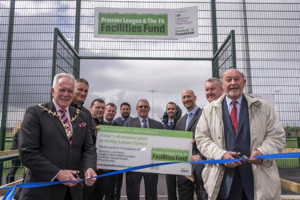 Mayor of Knowsley, Cllr Frank Walsh, and Lord Pendry, President of the Football Foundation, cut the ribbon at the official opening of Kirkby's new 3G pitch, watched by invited guests.