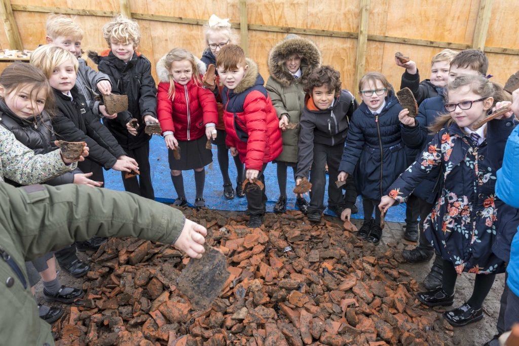 Archaeological open day at Mill Street in Prescot, the site of the Shakespeare North Playhouse with children from St John Fisher Primary School.