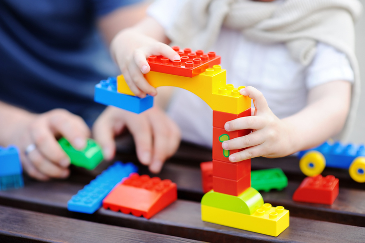 Child plays with colourful building blocks