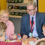 George Howarth MP sits with children at Park Brow School, Kirkby
