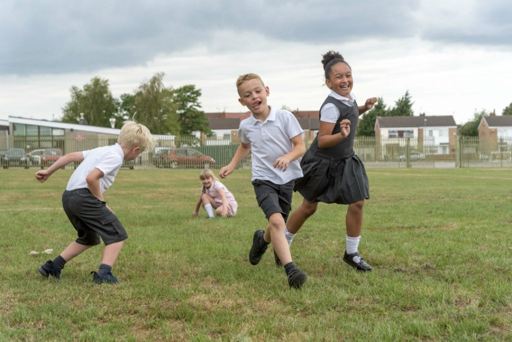 Roby Park Primary pupils celebrate the news of investment in their playing field