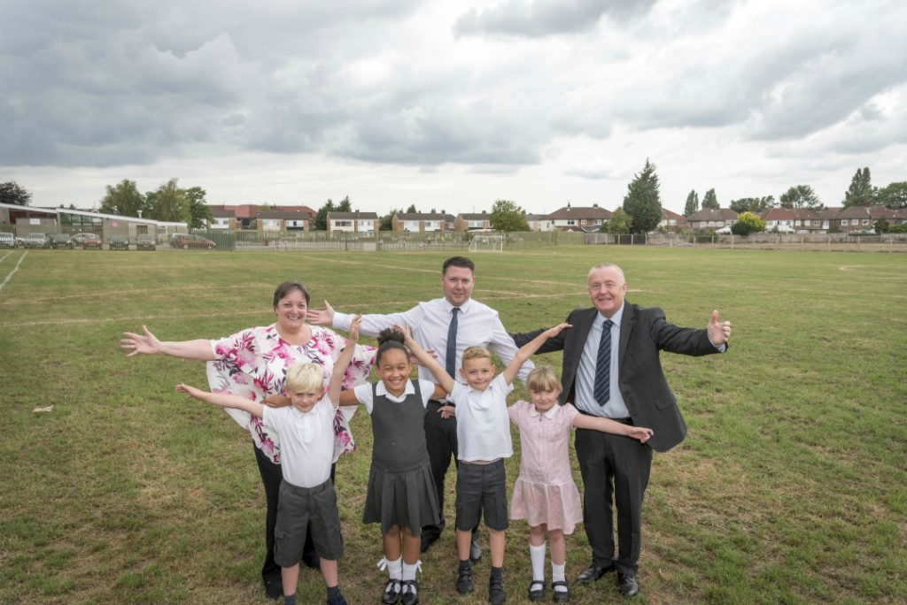 Cllr Margaret Harvey with Head Teacher Steven Hatton and Cllr Tony Brennan with Roby Park Primary pupils