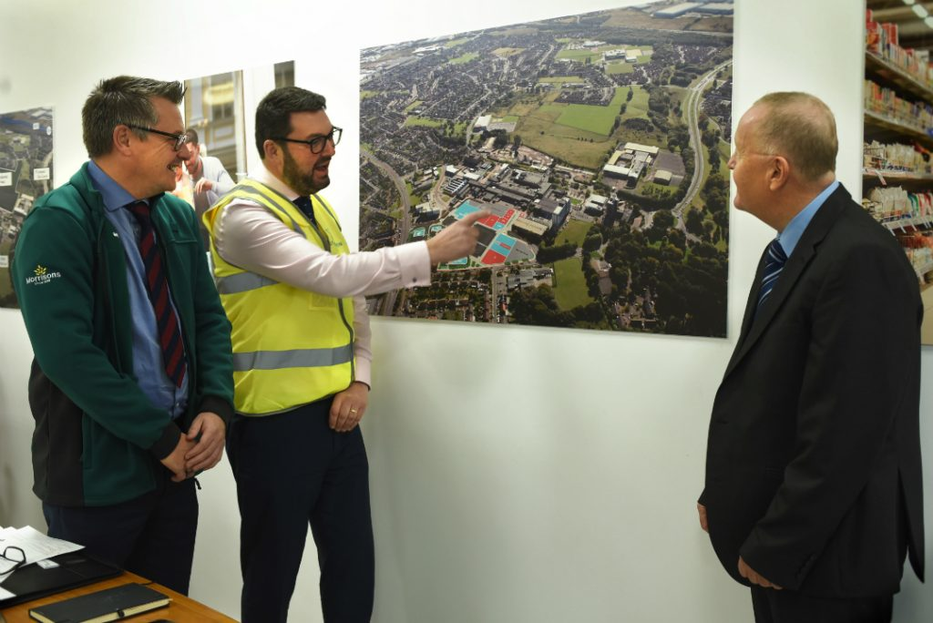 James Smith from Morrisons, Paul Batho from St Modwen and Cllr  Tony Brennan looking over the plans for the Kirkby Town Centre redevelopment.