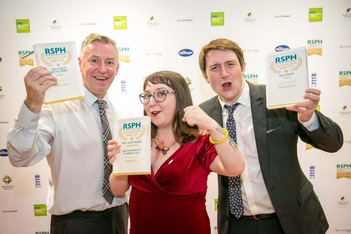 2 men and 1 woman celebrate winning 3 awards