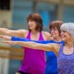 Three older ladies doing yoga
