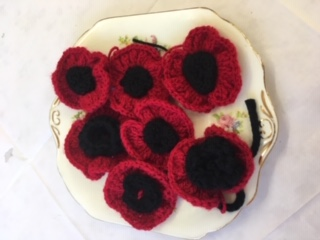 Hand knitted poppies are being sold by service users at the Kirkby Resource Centre for Older People ahead of Remembrance Day