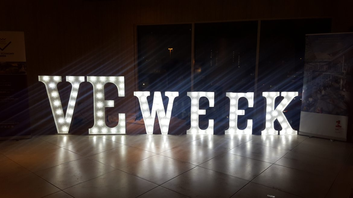 Illuminated white letters spell out VE Week - which stands for Visitor Economy Week