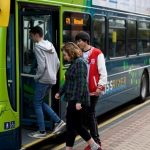 Passengers boarding Liverpool City Region bus